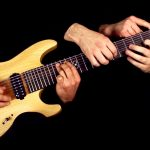 Playing Metallica's 'One' with 6 hands and an 8 string guitar